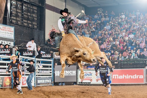 Veteran bull rider Elliot Jacoby from Fredericksburg, Tx covers his bull Show Me from Elite Bucking Bulls for 88.5 points in the first round of competition. (Todd Brewer)