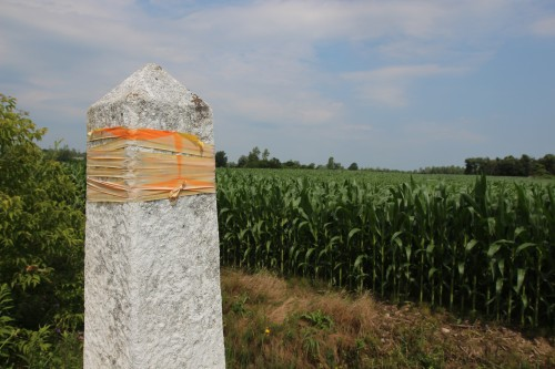 The obelisk in the foreground marks the US-Canada border. The corn field in in the Canadian Province of Quebec. (Lorne Matalon)