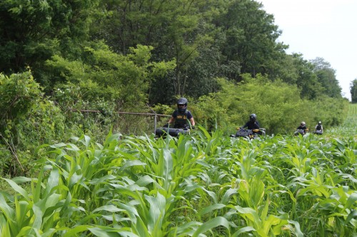 US Border Patrol agents and members of Canada's federal police agency, the RCMP, on ATVs hugging the contour of the border in Vermont. (Lorne Matalon)