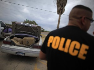 A car filled with bales of marijuana is seen at a police station in La Grulla, Texas on March 28, 2013. A lot of narcotics pass through the Border Patrol inspection station in Brooks County, where La Grulla is located; it, too, is refusing to take checkpoint cases. (Eric Thayer/Reuters/Landov)