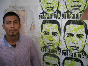 Diego next to posters of his brother Jose. The agent involved in Jose's death will be the first ever charged with murder for a cross-border shooting. (John Burnett/NPR)