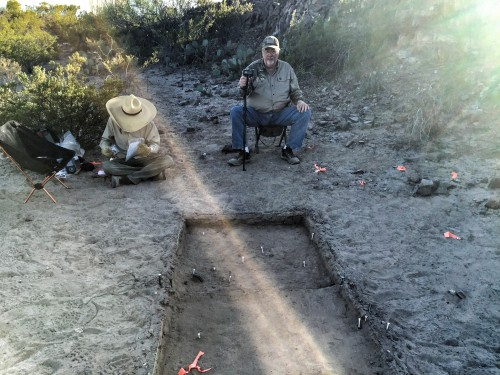 Archeologist David Keller (left) and historian Glenn Justice at the Porvenir Massacre Site as a ray of sunlight streaks across the excavation unit where the victims are believed to have been killed (Jessica Lutz).