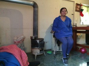 Brenda Estrada was an employee at a CommScope factory in Ciudad Juárez. She heats her three-room home with a makeshift fireplace made from a recycled trash bin. (Mónica Ortiz Uribe)