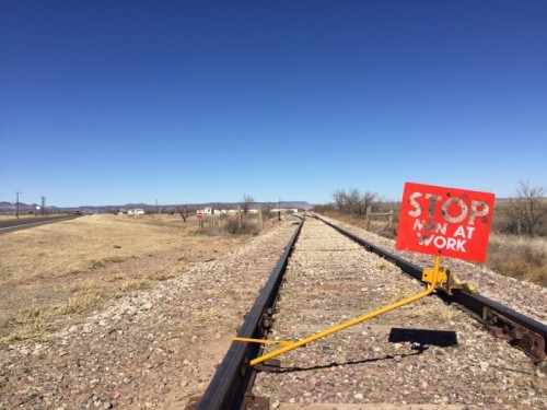 Pipeline segments were unloaded on private land north of Alpine, out of sight from town. (Travis Bubenik/KRTS)