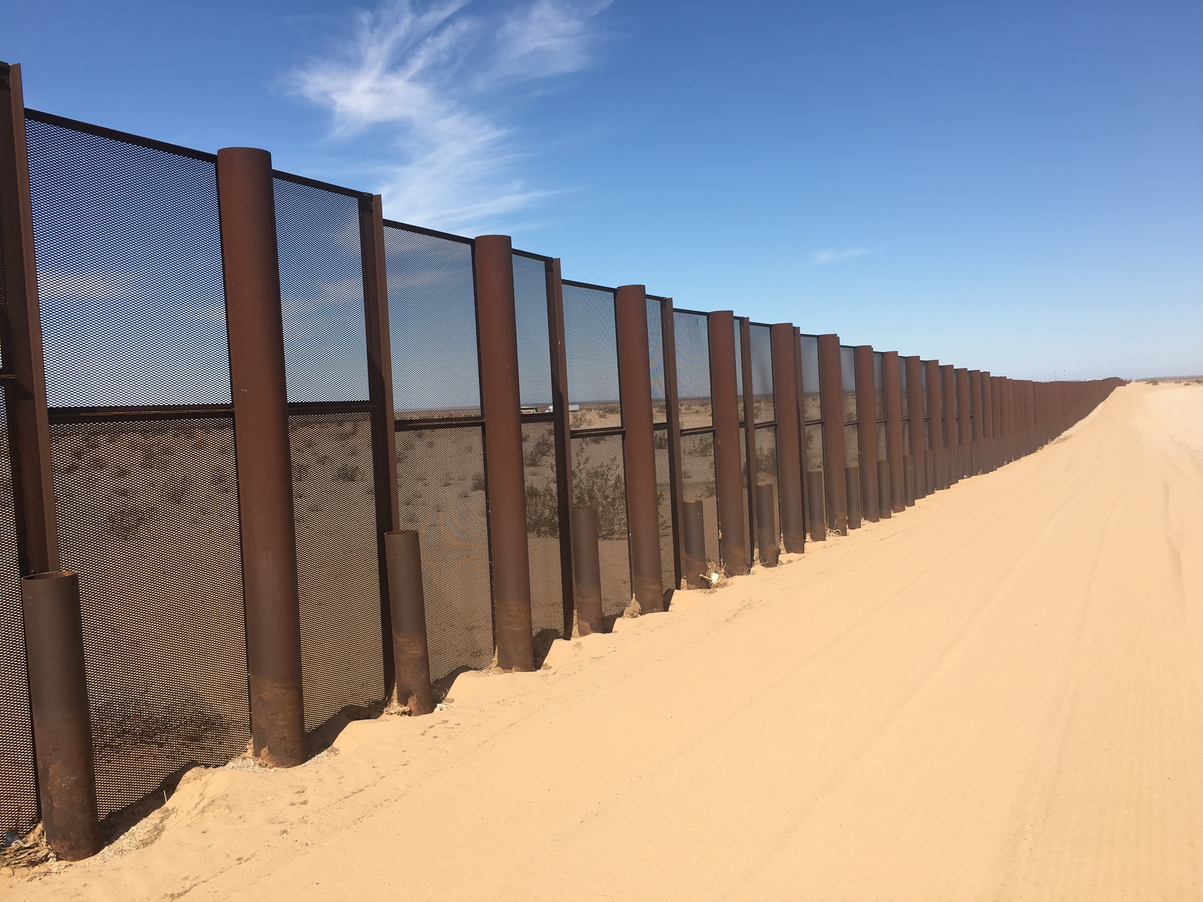 The border fence runs about $6.5 million per mile. It's worked to staunch the flow of illegal entries by Mexicans but now Yuma is seeing a rise in Central Americans crossing this fence in search of asylum. (Michel Marizco)