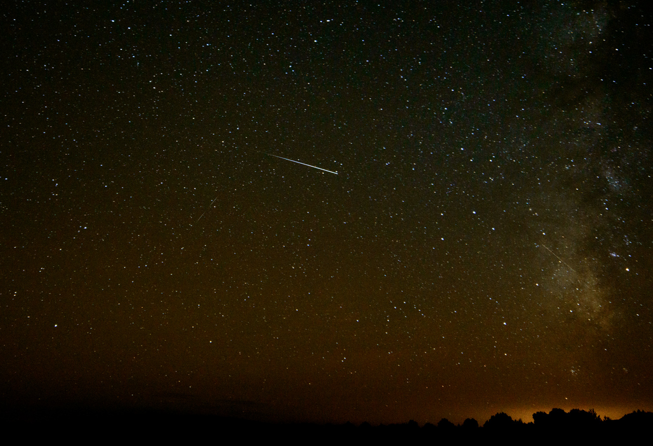 A meteor shoots across the sky above the Cosmic Campground in New Mexico. (David Thornburg)