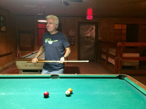 At the Lost Horse Saloon in Marfa, TX., John Bernhard shoots a game of pool instead of watching the last presidential debate. He's not voting this year. (Travis Bubenik/KRTS)